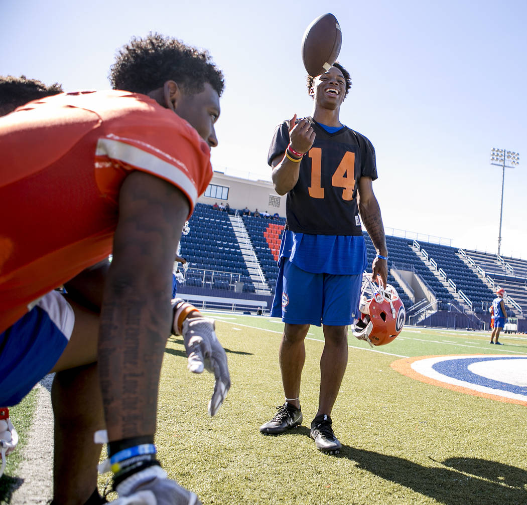 Bishop Gorman quarterback Dorian Thompson Robinson tosses the ball during practice at Fertitta Field at Bishop Gorman High School Monday, Aug. 21, 2017, in Las Vegas. Bridget Bennett Las Vegas Rev ...