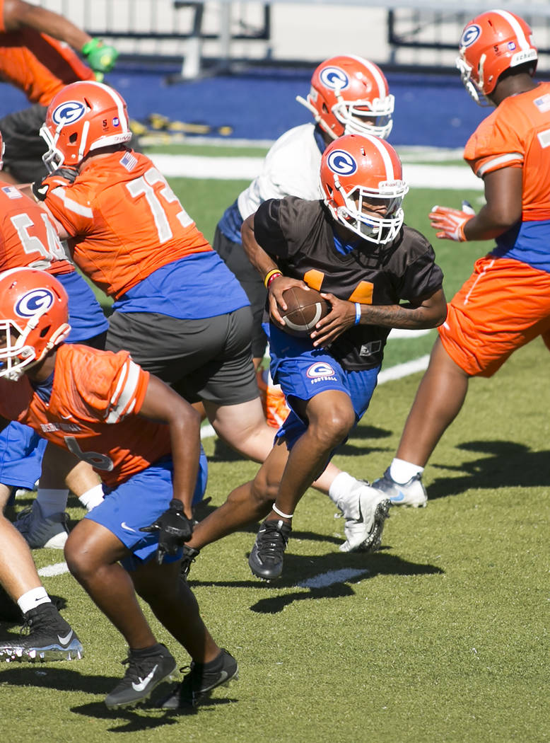 Bishop Gorman quarterback Dorian Thompson Robinson runs the ball during practice with his team at Fertitta Field at Bishop Gorman High School Monday, Aug. 21, 2017, in Las Vegas. Bridget Bennett L ...