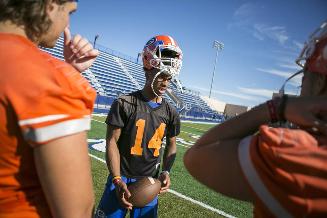 Bishop Gorman quarterback Dorian Thompson Robinson talks with teammates during practice at Fertitta Field at Bishop Gorman High School Monday, Aug. 21, 2017, in Las Vegas. Bridget Bennett Las Vega ...