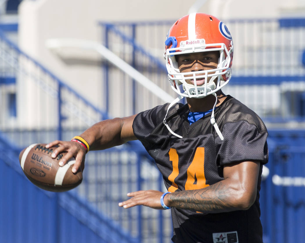Bishop Gorman quarterback Dorian Thompson Robinson passes the ball during practice at Fertitta Field at Bishop Gorman High School Monday, Aug. 21, 2017, in Las Vegas. Bridget Bennett Las Vegas Rev ...