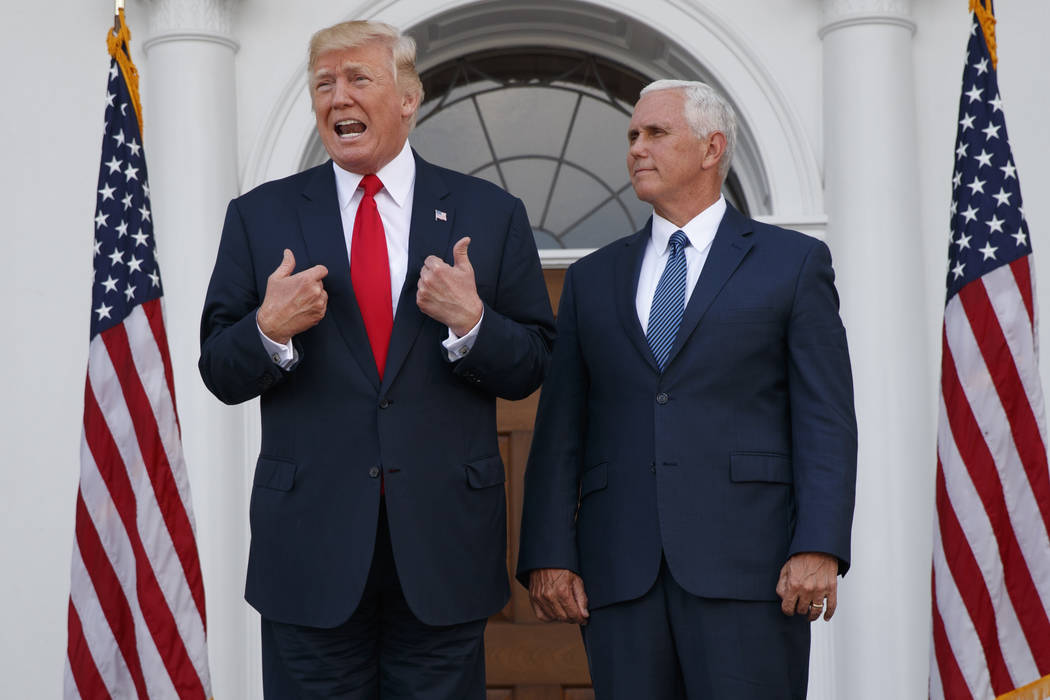 President Donald Trump, accompanied by Vice President Mike Pence, speaks to reporters at Trump National Golf Club in Bedminster, N.J. (AP Photo/Evan Vucci)