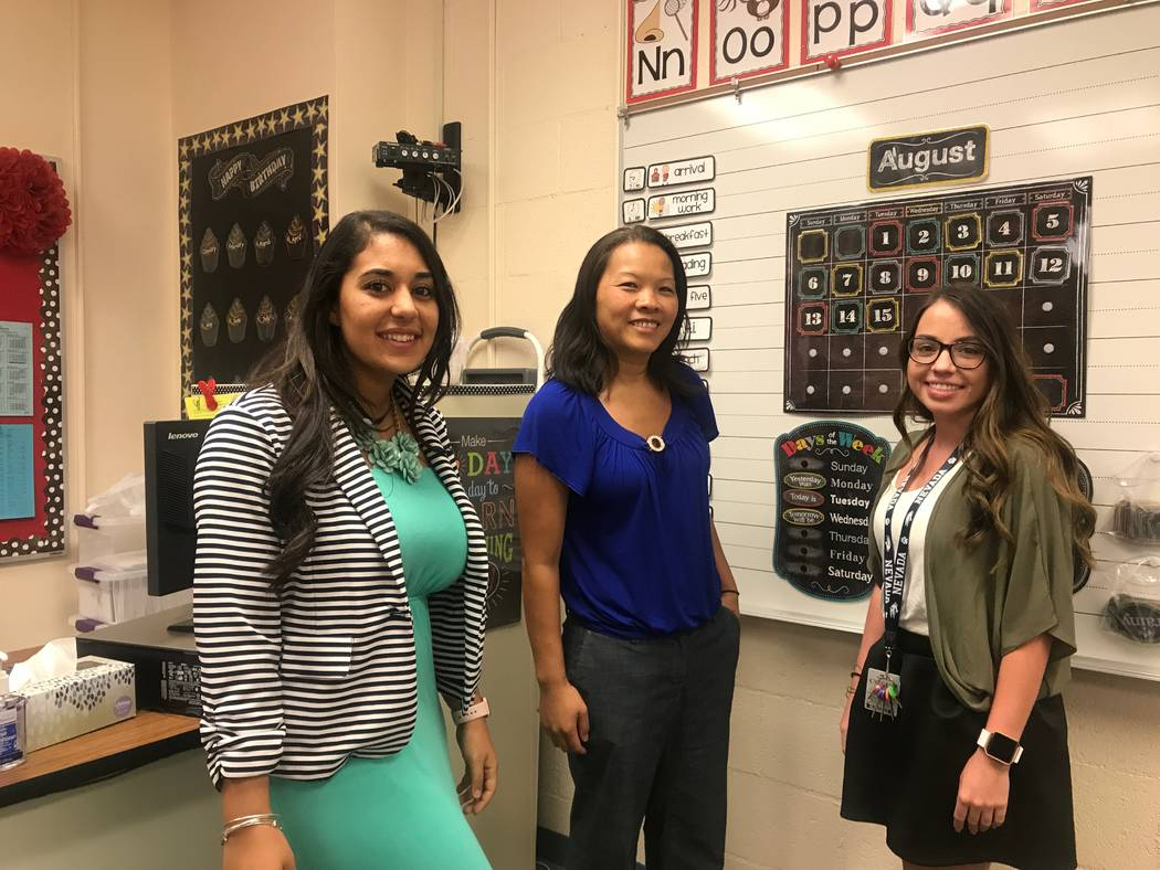 First grade teachers Madonna Hakim, left, Le Carter and Emily Rios in a classroom on the second day of school on August 15, 2017 at Lucile S. Bruner Elementary School, 4289 Allen Lane. (Kailyn Bro ...