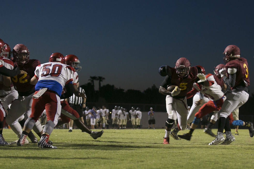 Del Sol senior Taariq Flowers runs to the end zone with the ball during a three-team scrimmage at Del Sol High School on Friday, Aug. 18, 2017, in Las Vegas. Bridget Bennett Las Vegas Review-Journ ...