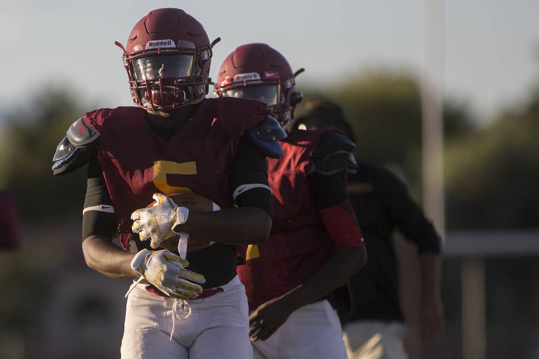 Del Sol senior Taariq Flowers holds the ball while he warms up before a three-team scrimmage at Del Sol High School on Friday, Aug. 18, 2017, in Las Vegas. Bridget Bennett Las Vegas Review-Journal ...