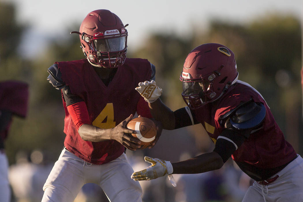 Del Sol sophomore Maalik Flowers, left, hands the ball off to his brother and teammate Taariq Flowers during a three-team scrimmage at Del Sol High School on Friday, Aug. 18, 2017, in Las Vegas. B ...