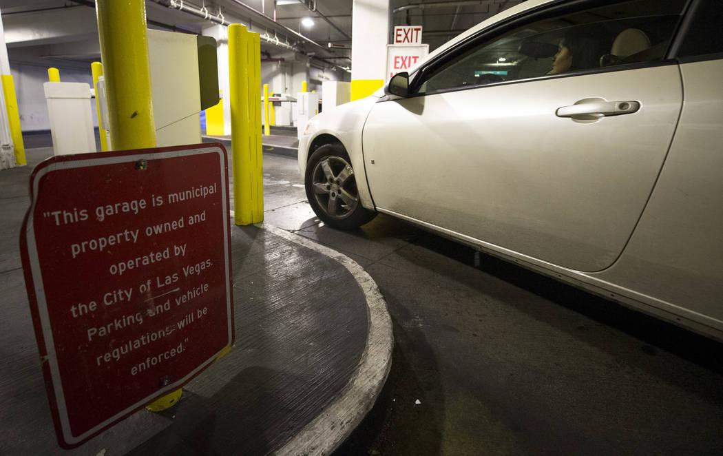 A driver exits the Neonopolis underground parking garage at 450 Fremont St. in downtown Las Vegas Thursday, Aug. 17, 2017. (Richard Brian/Las Vegas Review-Journal) @vegasphotograph