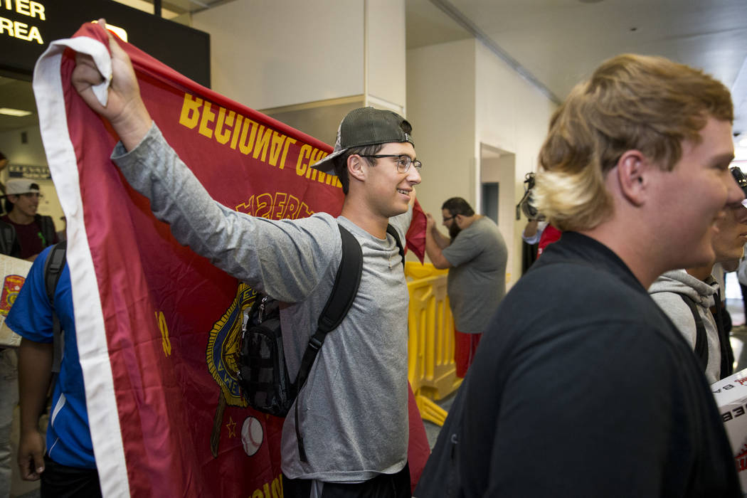 Southern Nevada Blue Sox baseball player Jesse Fonteboa, 17, arrives to McCarran International Airport with his team after their victory in the American Legion World Series championship, in Las Ve ...