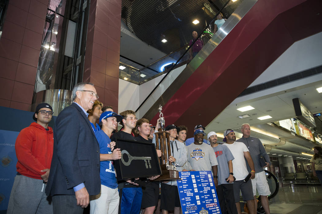 The Southern Nevada Blue Sox baseball team are greeted to a ceremony in their arrival to McCarran International Airport after their American Legion World Series championship victory, in Las Vegas, ...