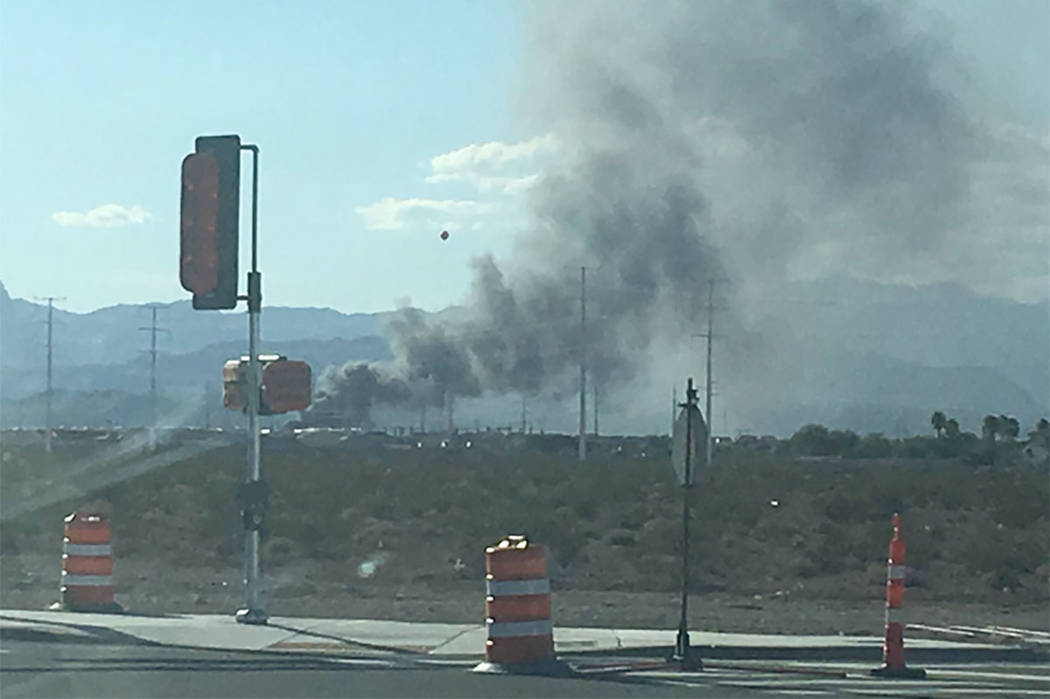 A large fire is seen in the southwest valley. (Caitlin Lilly/Las Vegas Review-Journal)