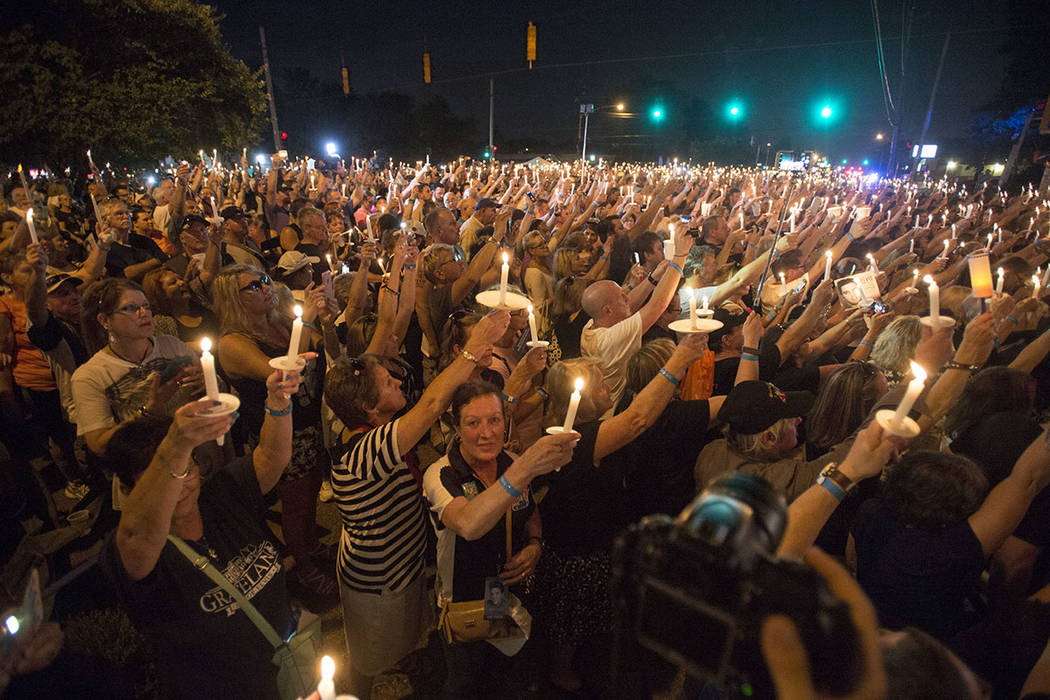 Fans hold candles during a vigil for Elvis Presley at Graceland, Presley's Memphis home, Tuesday, Aug. 15, 2017, in Memphis, Tenn. Fans from around the world are at Graceland for the 40th annivers ...