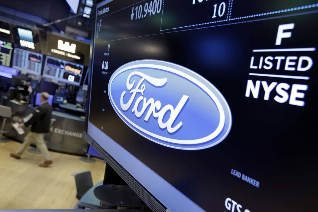 Ford Motor Co. has agreed to pay up to $10.1 million to settle sexual and racial harassment allegations by workers. (Richard Drew/AP)