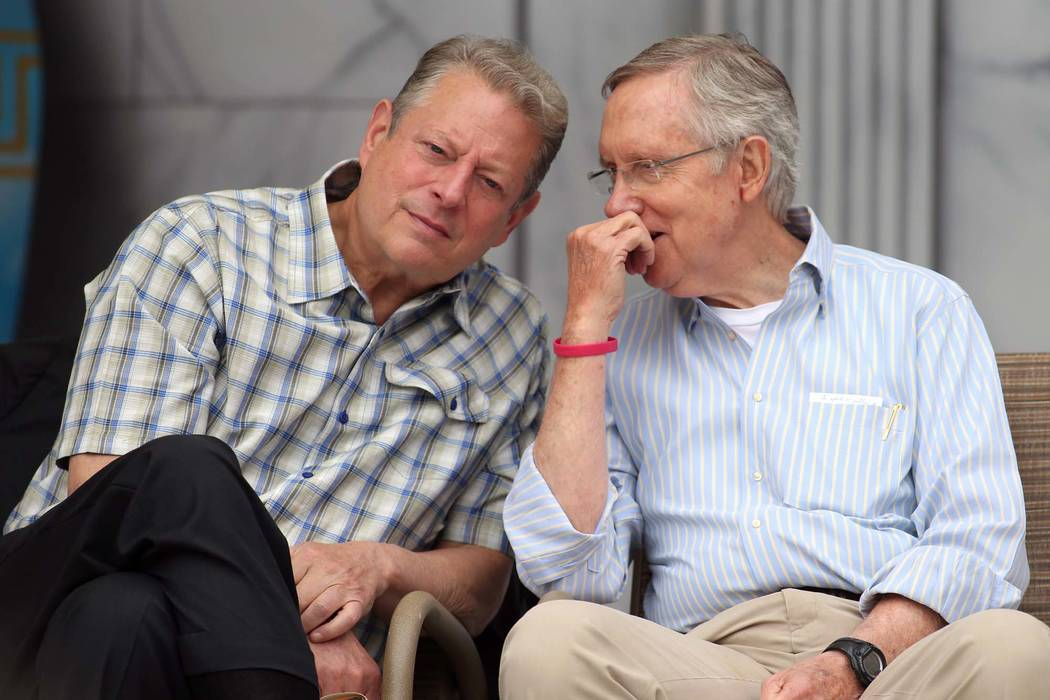 Former Vice President Al Gore and Senate Majority Leader Harry Reid talk at the 17th annual Lake Tahoe Summit conference at Sand Harbor, near Incline Village, Monday, Aug. 19, 2013. (Cathleen Alli ...