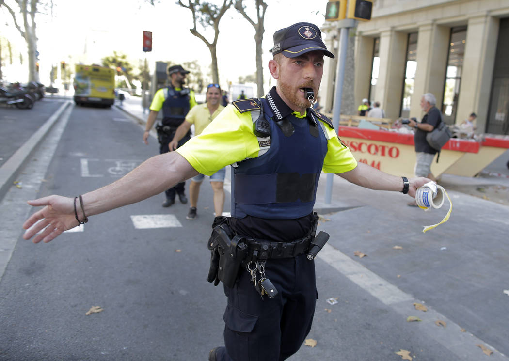 A police officer cordon off a street in Barcelona, Spain, Thursday, Aug. 17, 2017. Police in the northern Spanish city of Barcelona say a white van has jumped the sidewalk in the city's historic L ...