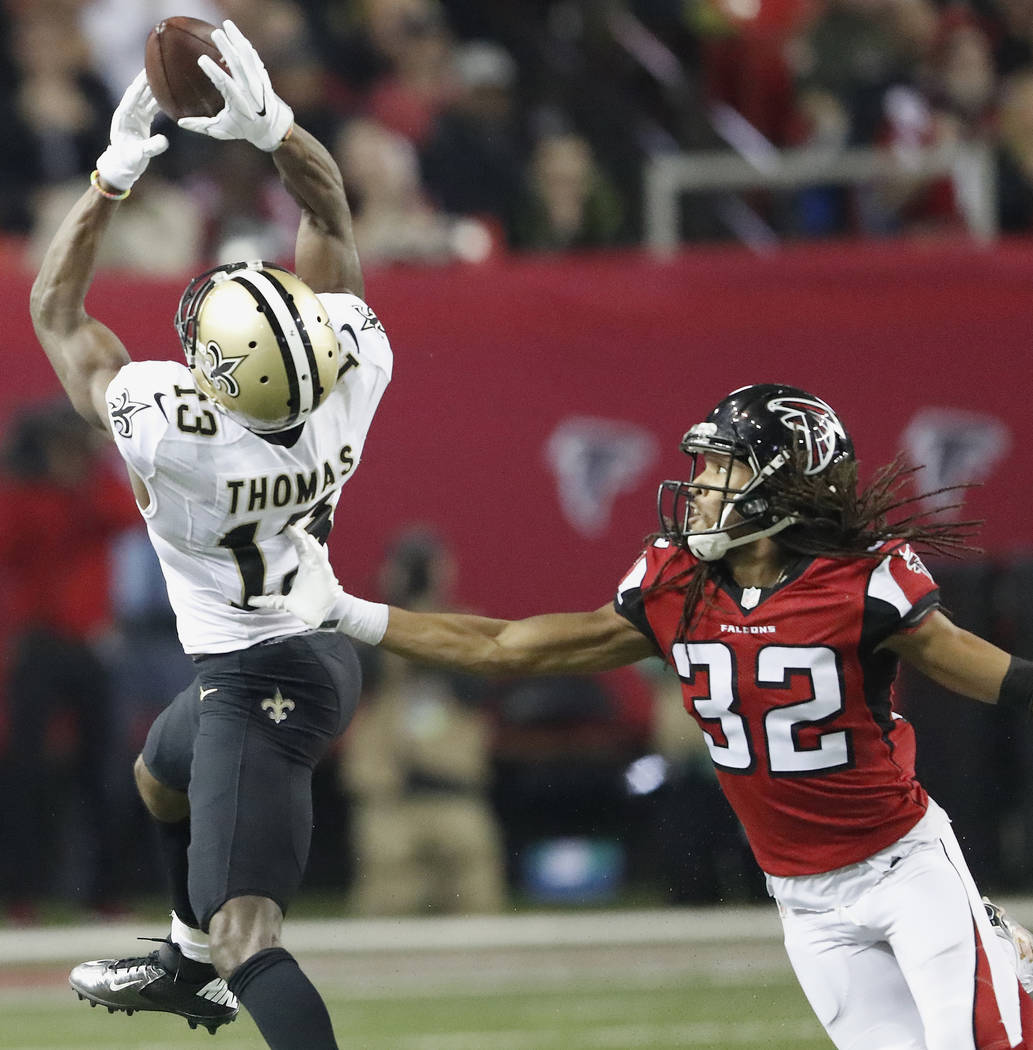 New Orleans Saints wide receiver Michael Thomas (13) makes the catch against Atlanta Falcons cornerback Jalen Collins (32) during the second half of an NFL football game, Sunday, Jan. 1, 2017, in  ...