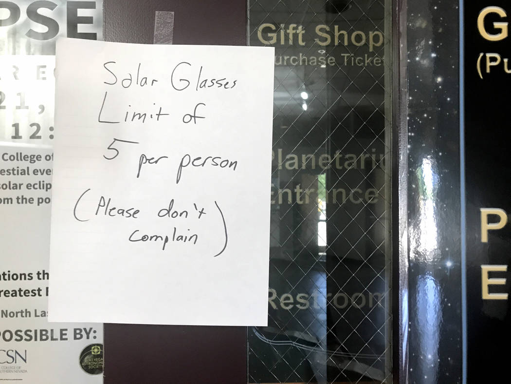 A sign hangs on the door of the College of Southern Nevada's Planetarium gift shop Thursday, Aug. 17, 2017, alerting customers to a buying limit for solar eclipse glasses. Jessie Bekker Las Vegas  ...