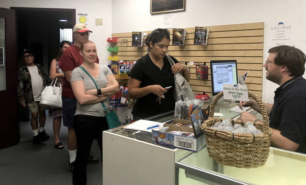 Customers wait in line at the College of Southern Nevada's Planetarium gift shop Thursday, Aug. 17, 2017, in hopes of buying one of the store's 1,000 solar eclipse glasses for sale. Jessie Bekker  ...