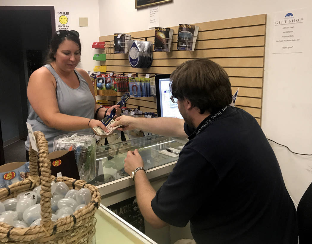 Anna Wroble, 37, buys five pairs of solar eclipse glasses at the College of Southern Nevada's Planetarium Thursday, Aug. 17, 2017. Jessie Bekker Las Vegas Review-Journal