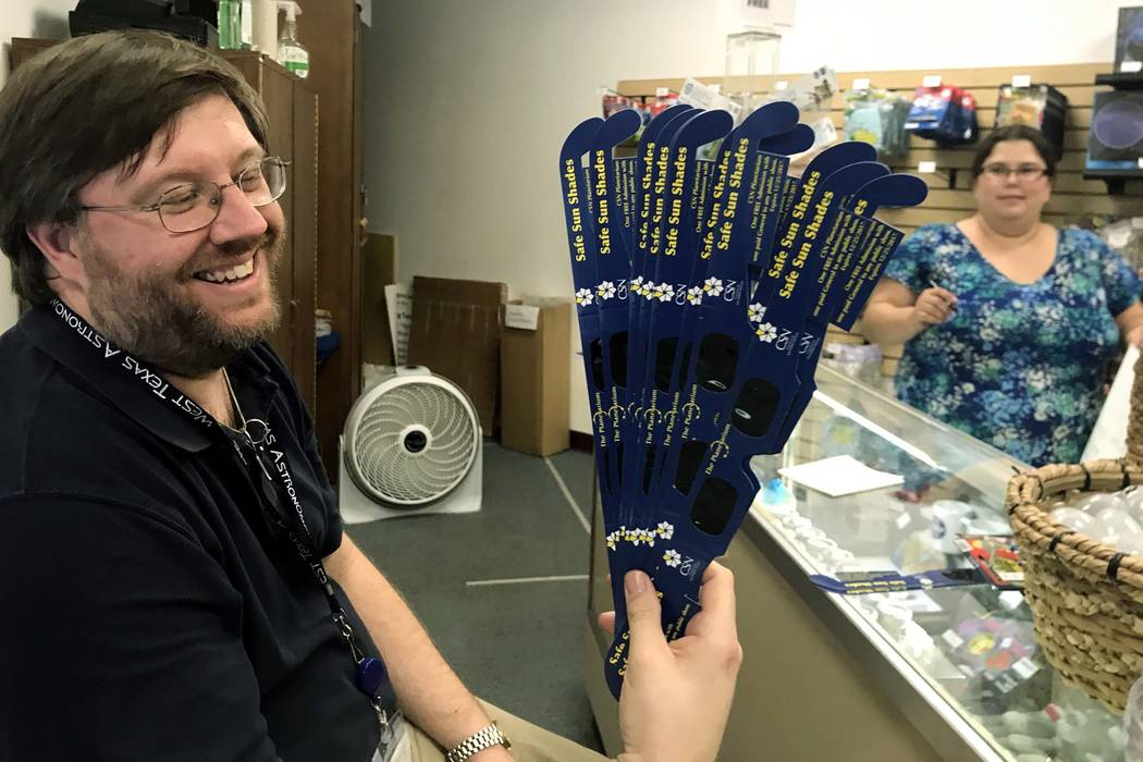 College of Southern Nevada Planetarium manager Andrew Kerr with the last of the day's solar eclipse glasses for sale at the gift shop, Aug. 17, 2017. (Jessie Bekker/Las Vegas Review-Journal)