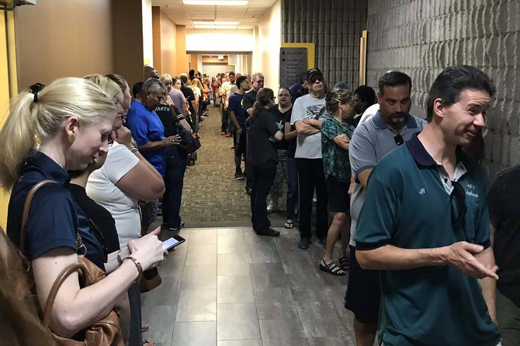 A long line of people wait to buy eclipse glasses at the College of Southern Nevada on Friday, Aug. 18, 2017. (Carri Geer/Las Vegas Review-Journal)