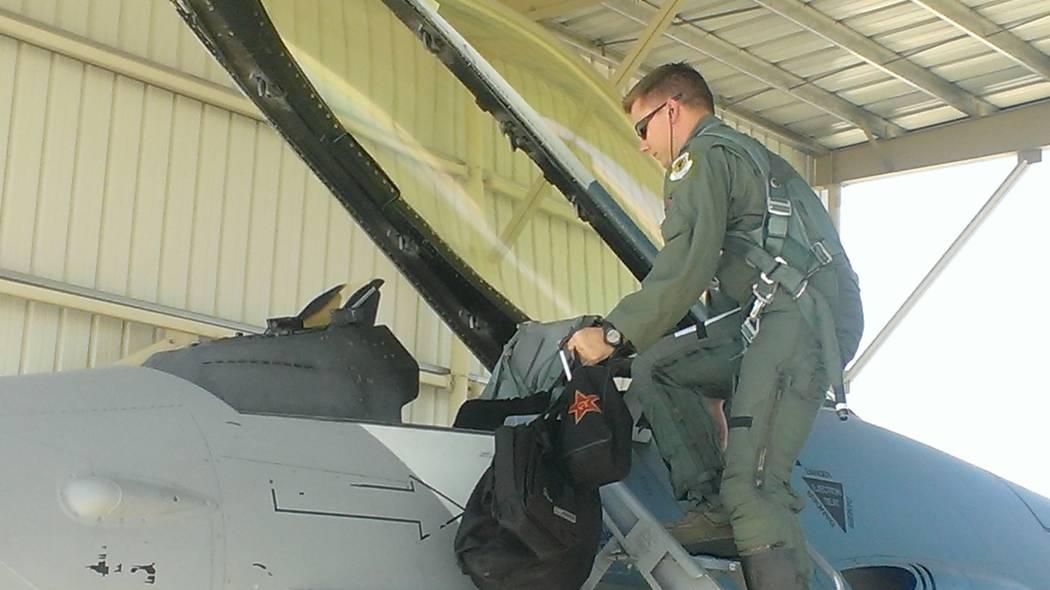 Jonathan Saxon/Las Vegas Review-Journal Captain James Bellamy enters the cockpit of his F-16 at Nellis AFB