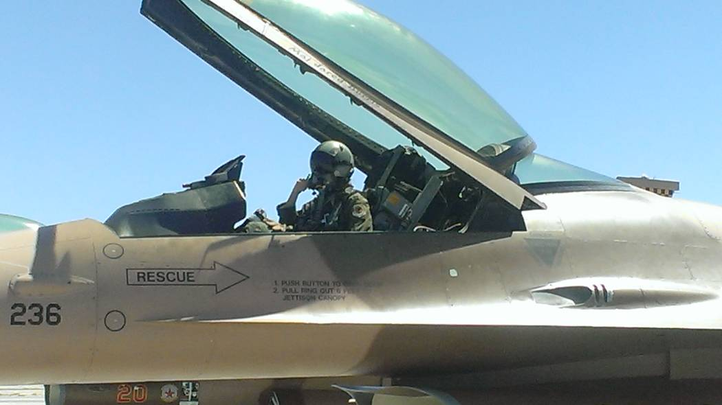 Jonathan Saxon/Las Vegas Review-Journal Captain Danielle Kangas straps into her F-16 and gets ready for takeoff at Nellis AFB.