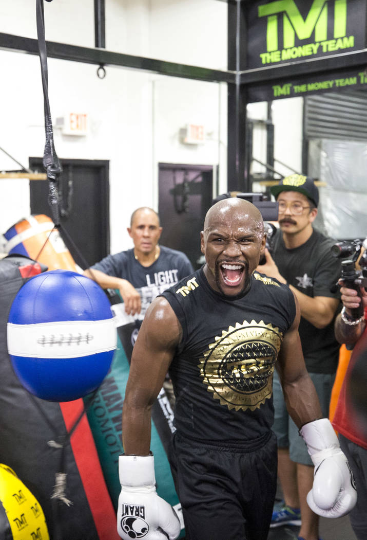 """Undefeated American boxer Floyd """"Money"""" Mayweather Jr. screams as he works out for the media at his gym on Thursday, August 10, 2017, in Las Vegas. Mayweather is scheduled to fight Conor McGregor  ..."""