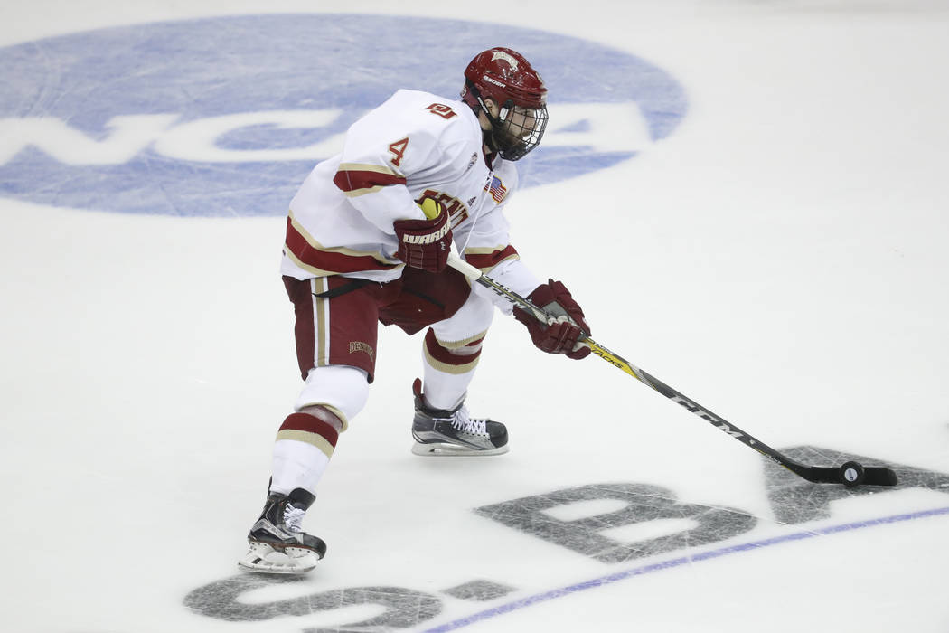 Denver's Will Butcher skates the puck up the ice in the second period during the midwest regional final of the NCAA college hockey tournament against Penn State, Sunday, March 26, 2017, in Cincinn ...