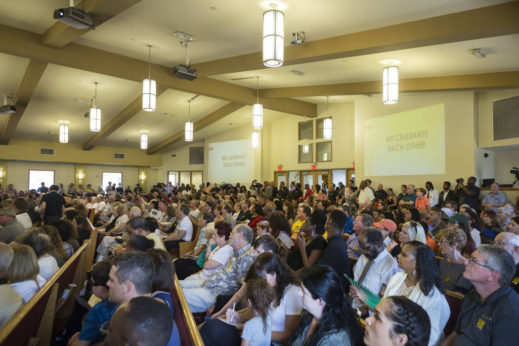 People gather at a vigil for peace and unity and for Las Vegans to stand shoulder-to-shoulder in denouncing anti-Semitism, racism and bigotry  at the First African Methodist Episcopal Church in No ...