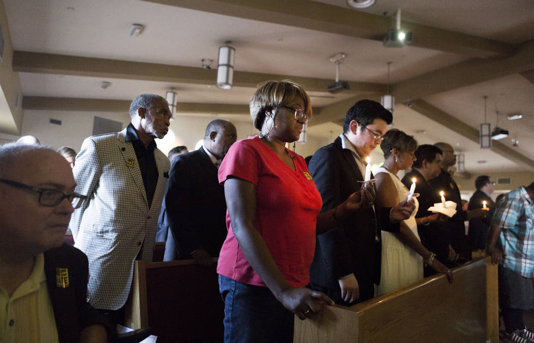 A moment of silence is given for those fallen in Virginia  during a vigil for peace and unity and for Las Vegans to stand shoulder-to-shoulder in denouncing anti-Semitism, racism and bigotry  at t ...