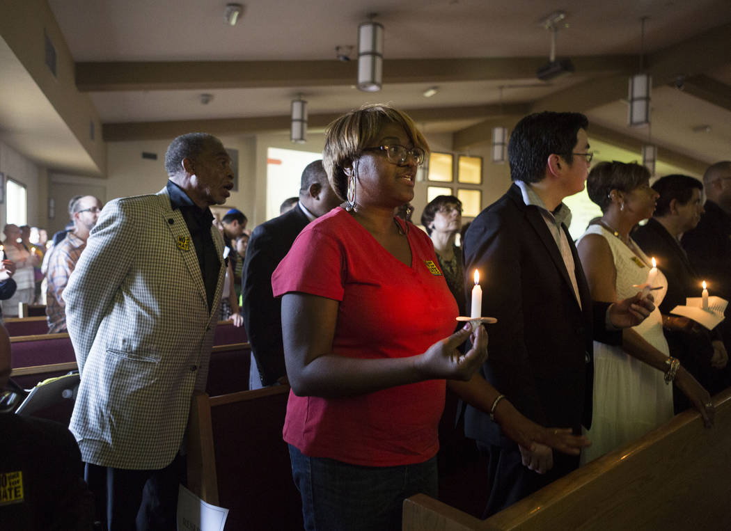 A hymn is sung during a vigil for peace and unity and for Las Vegans to stand shoulder-to-shoulder in denouncing anti-Semitism, racism and bigotry  at the First African Methodist Episcopal Church  ...