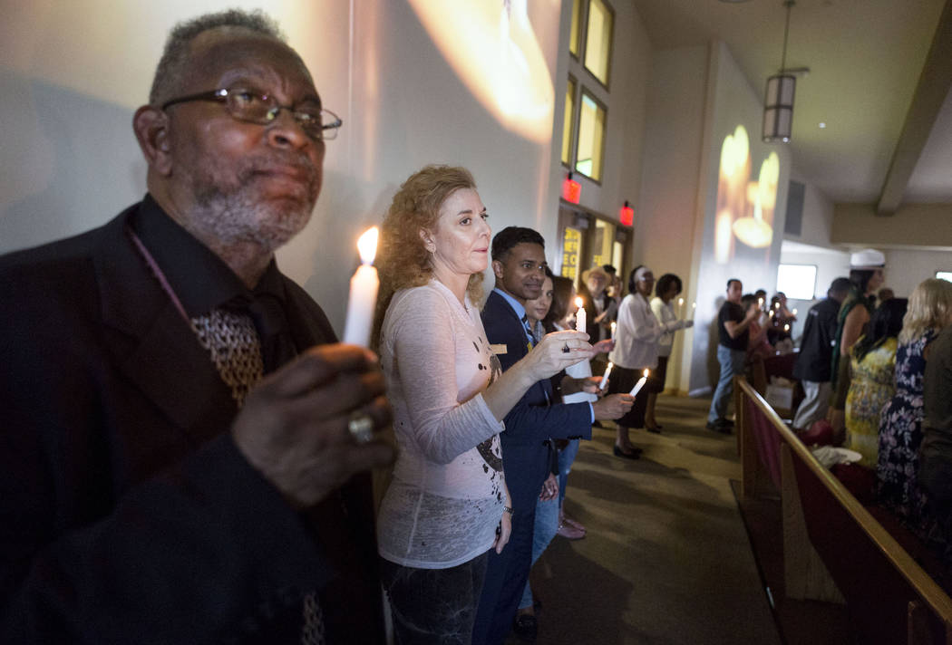 A moment of silence is given during a vigil for peace and unity and for Las Vegans to stand shoulder-to-shoulder in denouncing anti-Semitism, racism and bigotry  at the First African Methodist Epi ...