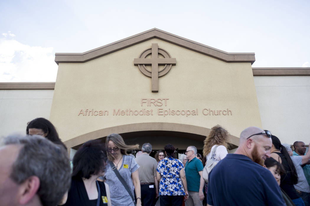 People leave the vigil for peace and unity and for Las Vegans to stand shoulder-to-shoulder in denouncing anti-Semitism, racism and bigotry at the First African Methodist Episcopal Church in North ...