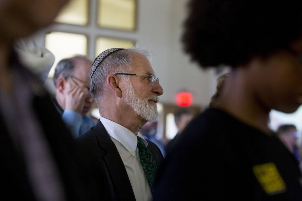 Rabbi Benjamin Katz listens during a vigil for peace and unity and for Las Vegans to stand shoulder-to-shoulder in denouncing anti-Semitism, racism and bigotry at the First African Methodist Episc ...