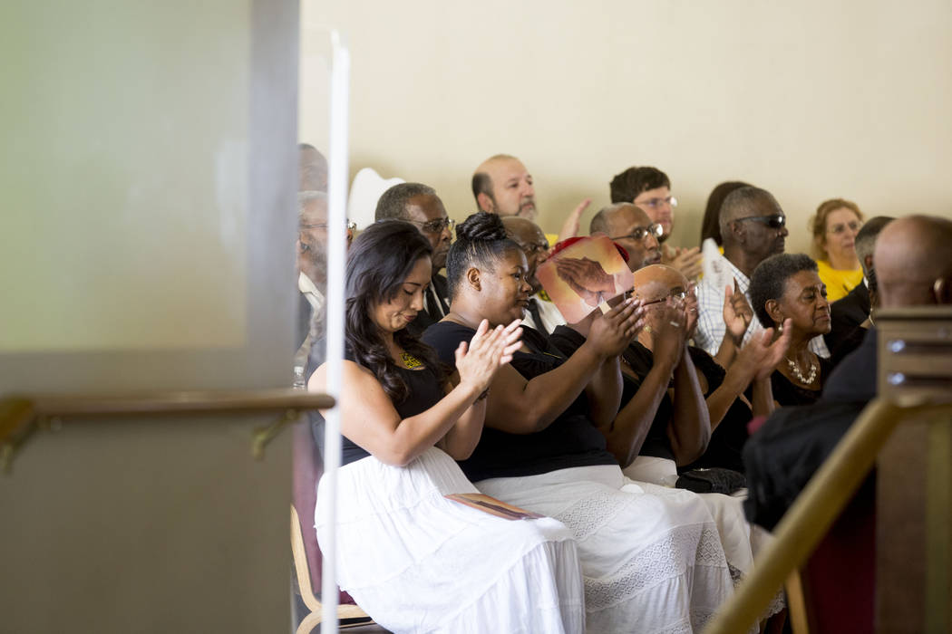 People attend a vigil for peace and unity and for Las Vegans to stand shoulder-to-shoulder in denouncing anti-Semitism, racism and bigotry at the First African Methodist Episcopal Church in North  ...