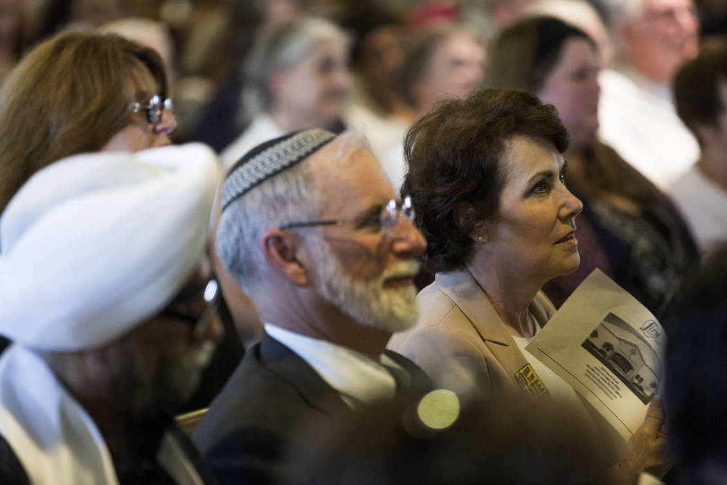 Rabbi Benjamin Katz, left, and congresswoman Jacky Rosen, listen during a vigil for peace and unity and for Las Vegans to stand shoulder-to-shoulder in denouncing anti-Semitism, racism and bigotry ...