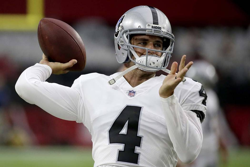 Oakland Raiders quarterback Derek Carr warms up prior to an NFL preseason football game against the Arizona Cardinals, Saturday, Aug. 12, 2017, in Glendale, Ariz. (AP Photo/Rick Scuteri)
