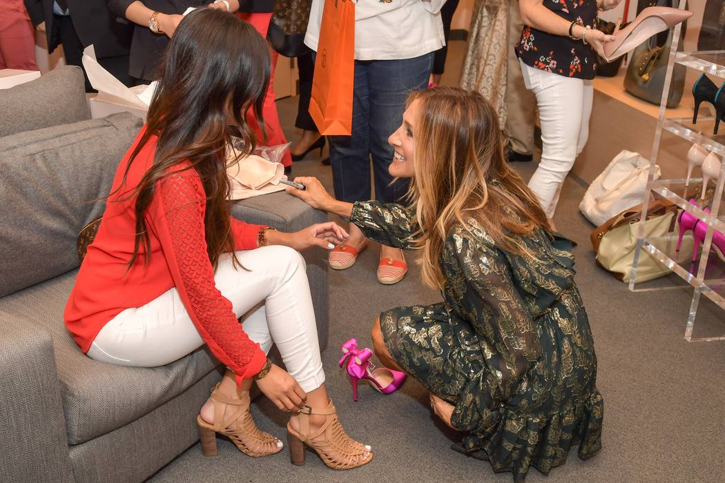 Sarah Jessica Parker greets a customer at the opening of her SJP Collection boutique at Bellagio on Monday, Aug. 14, 2017. (Robert Stanzione)