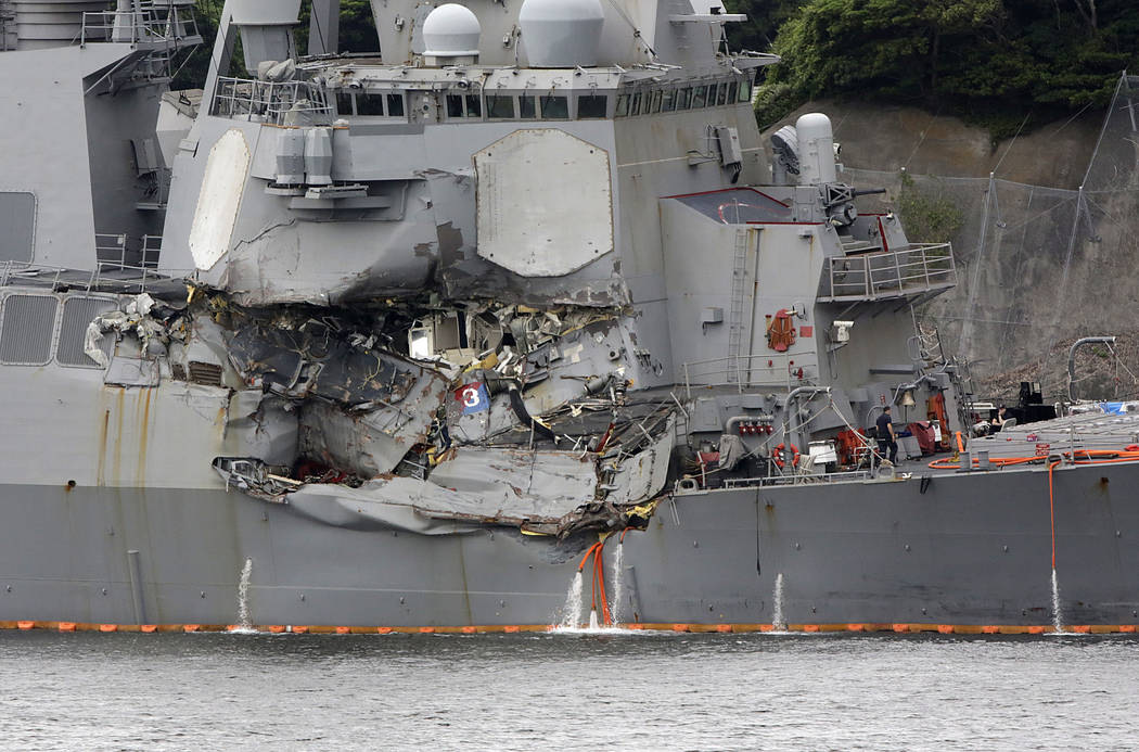 Damaged part of USS Fitzgerald is seen at the U.S. Naval base in Yokosuka, southwest of Tokyo Sunday, June 18, 2017.  (AP Photo/Eugene Hoshiko)