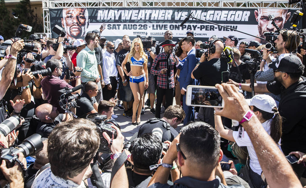 Floyd Mayweather Jr., middle, answers questions from the media at Toshiba Plaza outside T-Mobile Arena in advance of his Saturday night fight with Conor McGregor. Photo taken on Tuesday, Aug 22, 2 ...