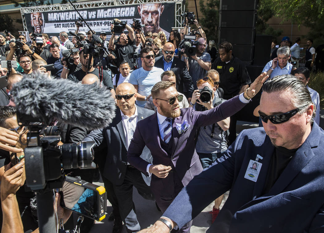 Conor McGregor, middle/right, waves to fans during his arrival at Toshiba Plaza outside T-Mobile Arena in advance of his Saturday night fight with Floyd Mayweather Jr. Photo taken on Tuesday, Aug  ...