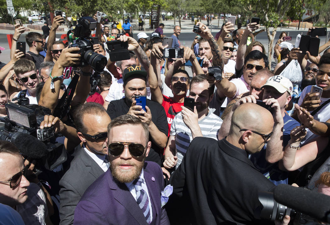 Conor McGregor, left, arrives at Toshiba Plaza outside T-Mobile Arena in advance of his Saturday night fight with Floyd Mayweather Jr. Photo taken on Tuesday, Aug 22, 2017, in Las Vegas. Benjamin  ...