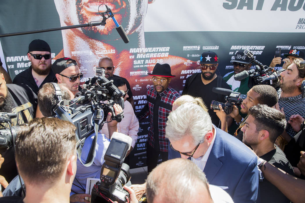 Floyd Mayweather Jr., middle, addresses the media at Toshiba Plaza outside T-Mobile Arena in advance of his Saturday fight with Connor McGregor. Photo taken on Tuesday, Aug 22, 2017, in Las Vegas. ...