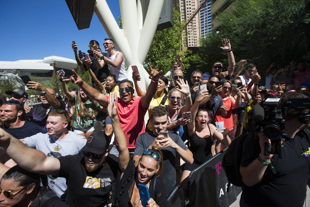 Fans cheer as Conor McGregor arrives ahead of his fight against Floyd Mayweather Jr. at Toshiba Plaza outside of the T-Mobile Arena in Las Vegas on Tuesday, Aug. 22, 2017. Chase Stevens Las Vegas  ...