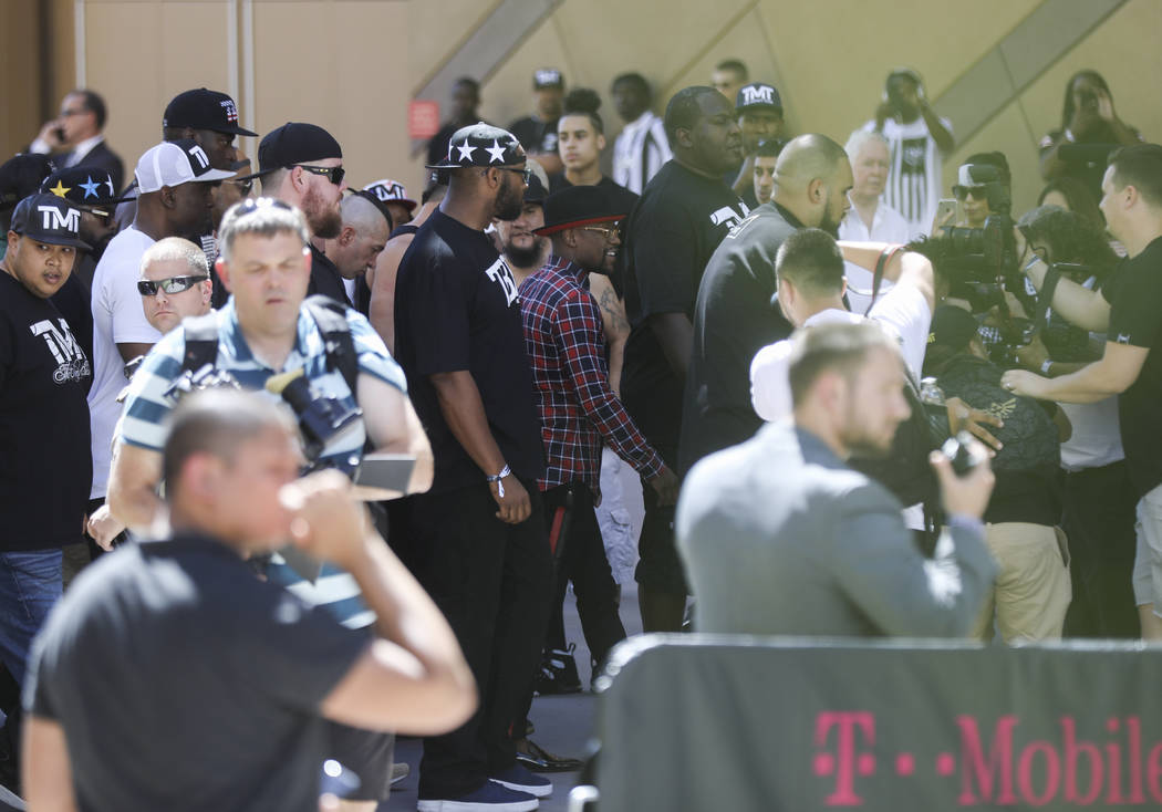 Floyd Mayweather Jr., center, arrives at Toshiba Plaza outside of the T-Mobile Arena, ahead of his fight against Conor McGregor, in Las Vegas on Tuesday, Aug. 22, 2017. Chase Stevens Las Vegas Rev ...