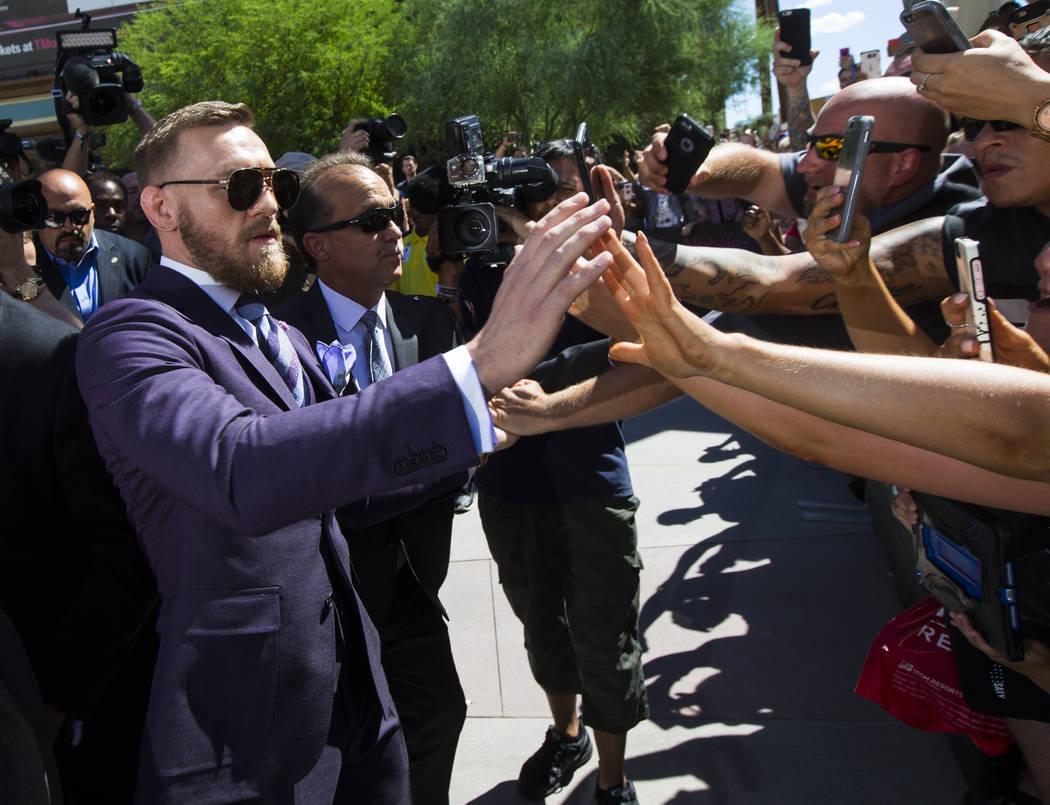 Conor McGregor greets fans as he arrives at Toshiba Plaza outside of the T-Mobile Arena, ahead of his fight against Floyd Mayweather Jr., in Las Vegas on Tuesday, Aug. 22, 2017. Chase Stevens Las  ...