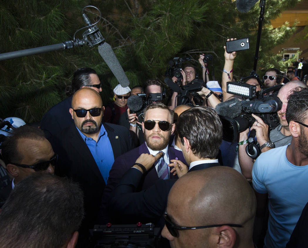 Conor McGregor, center, arrives at Toshiba Plaza outside of the T-Mobile Arena, ahead of his fight against Floyd Mayweather Jr., in Las Vegas on Tuesday, Aug. 22, 2017. Chase Stevens Las Vegas Rev ...