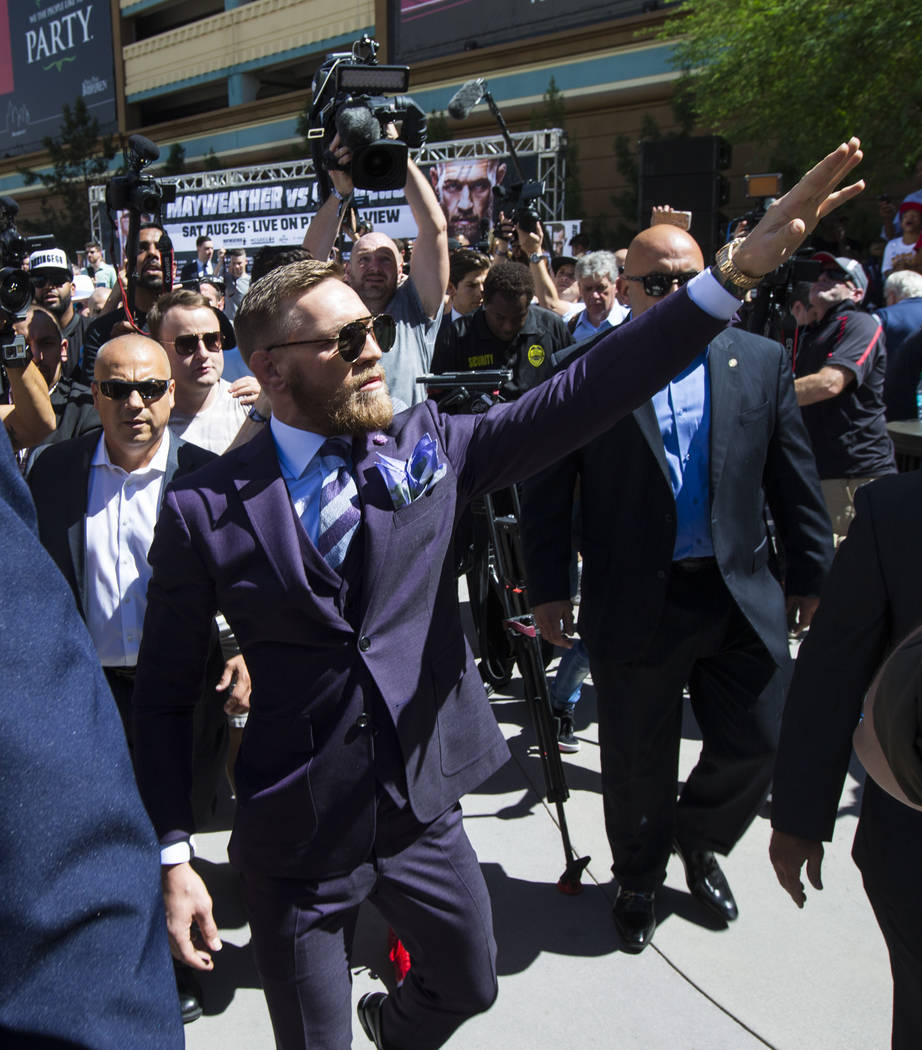 Conor McGregor waves to fans as he arrives at Toshiba Plaza outside of the T-Mobile Arena, ahead of his fight against Floyd Mayweather Jr., in Las Vegas on Tuesday, Aug. 22, 2017. Chase Stevens La ...