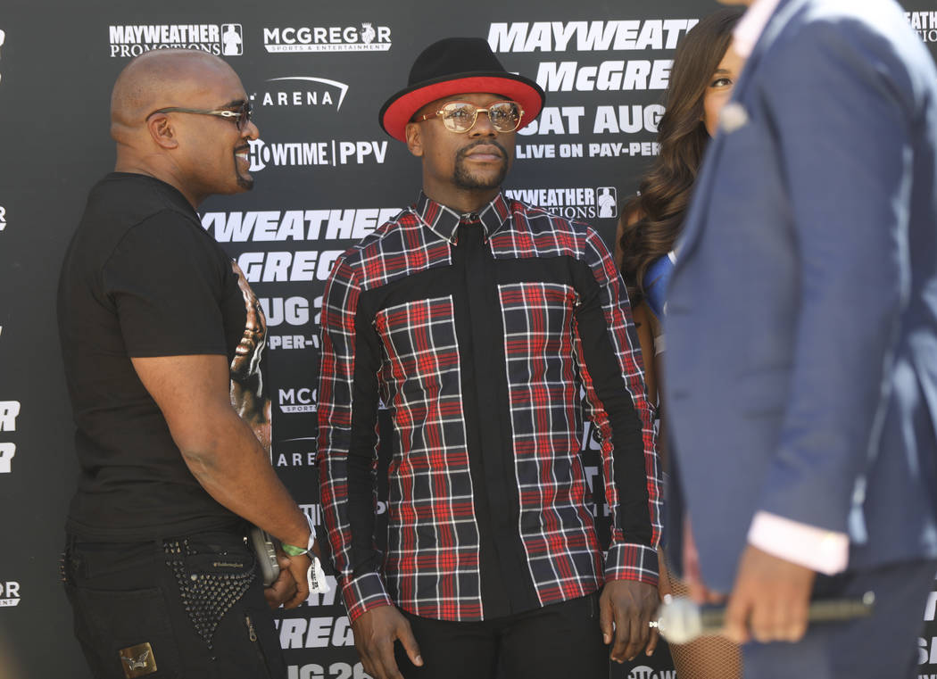 Mayweather Promotions CEO Leonard Ellerbe, left, and Floyd Mayweather Jr. at Toshiba Plaza outside of the T-Mobile Arena, ahead of his fight against Conor McGregor, in Las Vegas on Tuesday, Aug. 2 ...