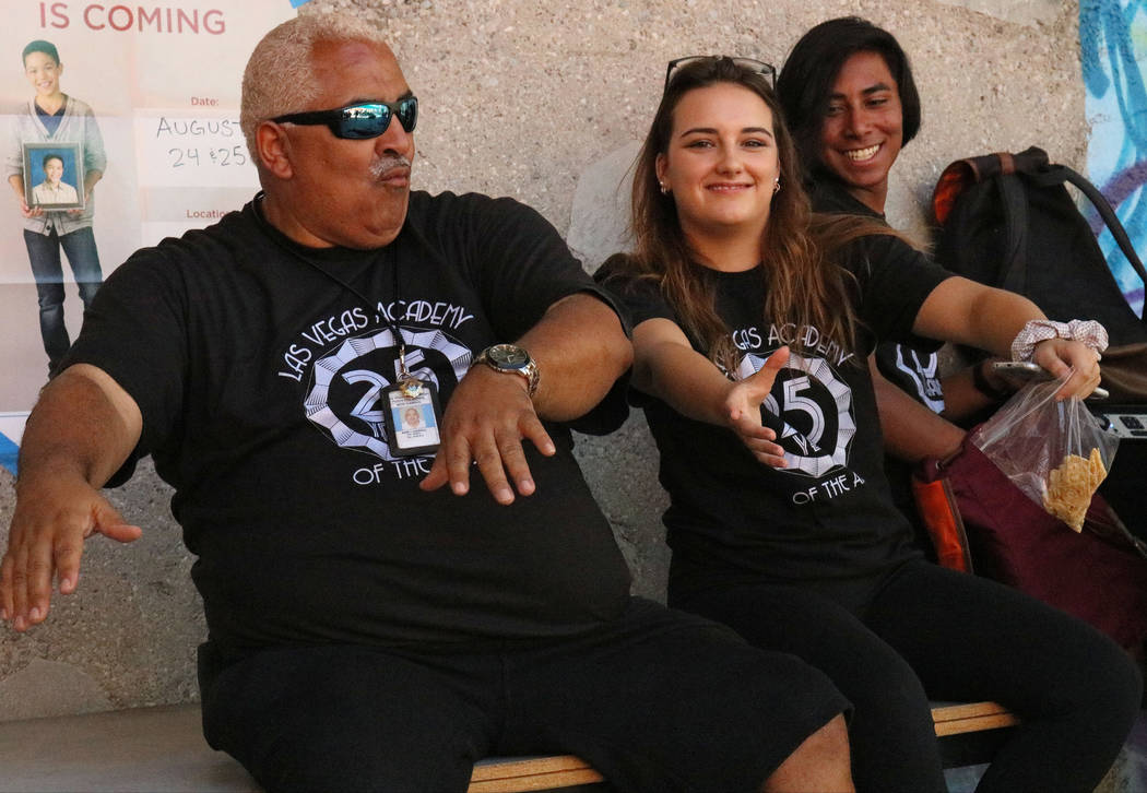 Campus security monitor Mark Campell, left, and Las Vegas Academy student Ceclia Rosage, 16, groove to music together at lunch during the school's 25th anniversary day, Friday, Aug. 18, 2017. Gabr ...