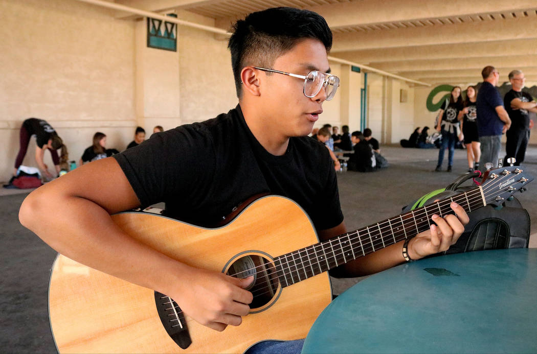 Las Vegas Academy student Paolo Uno, 16, practices playing the guitar at lunch during the school's 25th anniversary day, Friday, Aug. 18, 2017. Gabriella Benavidez Las Vegas Review-Journal @latina_ish